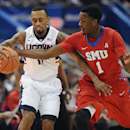 SMU's Ryan Manuel, right, guards Connecticut's Ryan Boatright during the first half of an NCAA college basketball game, Sunday, March 1, 2015, in Hartford, Conn. (AP Photo/Jessica Hill)