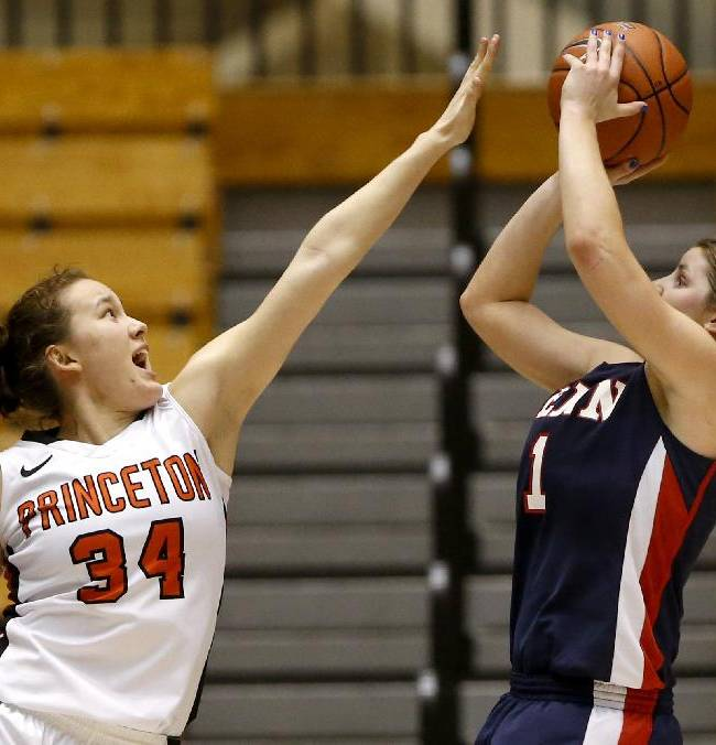 Penn guard Alyssa Baron, right, goes up for a shot against Princeton guard Michelle Miller during the second half of an NCAA college basketball game, Tuesday, March 11, 2014, in Princeton, N.J. Penn won 80-64
