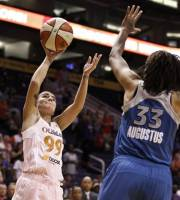 Minnesota Lynx's Seimone Augustus (33) defends against Phoenix Mercury's Samantha Prahalis (99) as she goes up for a shot during the first half of a WNBA basketball game Friday, Sept. 21, 2012, in Phoenix.(AP Photo/Ross D. Franklin)