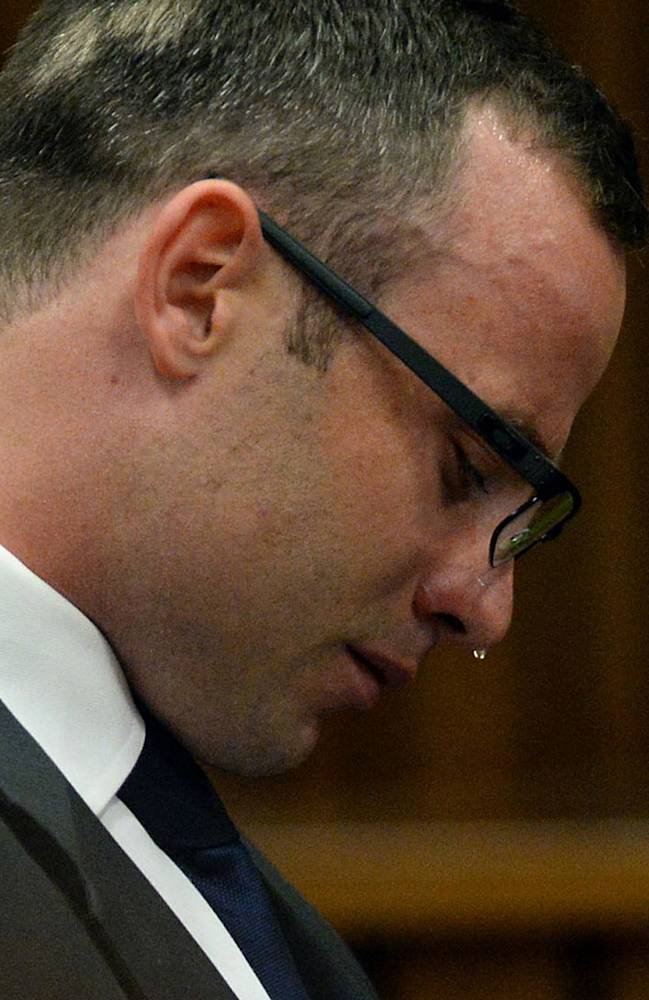 FILE: In this file photo taken Monday, March 24, 2014, Oscar Pistorius, cries in court as he listens to evidence being given in Pretoria, South Africa, in the murder trial for the shooting death of his girlfriend Reeva Steenkamp on Valentines Day 2013. Pistorius is expected to testify soon when the defense begins its case on Friday March 28, 2014, after four weeks of prosecution-led testimony. (AP Photo/Chris Collingridge, Pool, File)