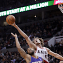 Portland Trail Blazers center Robin Lopez, right, reaches for a rebound over Phoenix Suns forward Marcus Morris during the second half of an NBA basketball game in Portland, Ore., Friday, April 4, 2014. Lopez scored 18 points as the Suns won 109-93 The As
