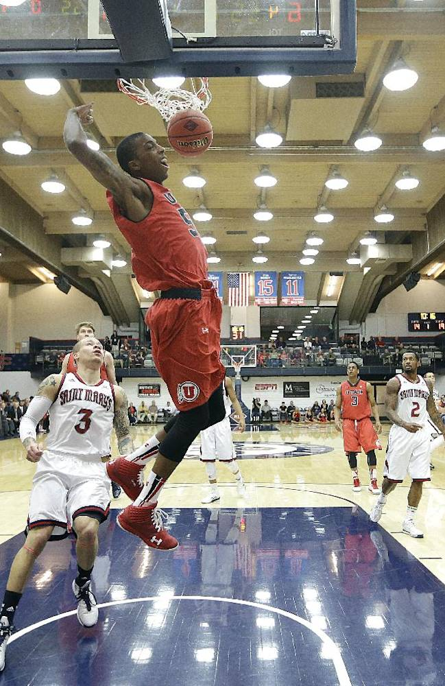 Utah guard Delon Wright (55) slam dunks the ball past St. Mary's guard Kerry Carter (3) during the first half of an NCAA college basketball game against Utah in the first round of the National Invitational Tournament in Moraga, Calif., Tuesday, March 18, 2014