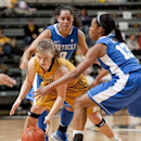 Missouri's Lianna Doty , left, tries to keep control of the ball as she is surrounded by Bria Goss , right, and Jennifer O'Neill, top during the first half of an NCAA college women's basketball game Sunday, Jan. 13, 2013, in Columbia, Mo. (AP Photo/L.G. Patterson)