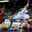 Creighton's Gregory Echenique (00) falls over Illinois State's Jon Ekey while chasing a rebound in the second half of an NCAA college basketball game in Omaha, Neb., Saturday, Feb. 9, 2013. Illinois State's Johnny Hill (44) watches. (AP Photo/Nati Harnik)