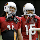 Arizona Cardinals receiver Larry Fitzgerald, left, and Michael Floyd laugh during an NFL football training camp, Tuesday, July 29, 2014, in Glendale, Ariz The Associated Press