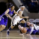Holy Cross guard Brisje Malone, left, and Navy guard Alix Membreno chase after a loose ball as Holy Cross forward Emily Parker and Navy forward Jade Geif watch during the first half of an NCAA college basketball game for the championship of the Patriot League tournament in Annapolis, Md., Saturday, March 16, 2013. (AP Photo/Patrick Semansky)