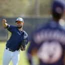 Milwaukee Brewers' Marco Estrada, left, warms up with teammate Yovani Gallardo, right, during Brewers spring training baseball practice, Thursday, Feb. 20, 2014, in Phoenix The Associated Press