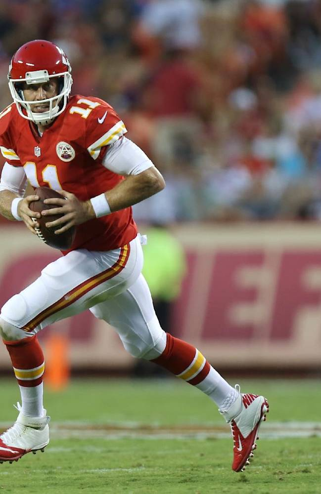 Kansas City Chiefs quarterback Alex Smith rolls out during the first half of an NFL preseason football game against the Minnesota Vikings in Kansas City, Mo., Saturday, Aug. 23, 2014