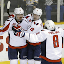 Washington Capitals left wing Marcus Johansson (90), of Sweden, celebrates with Nicklas Backstrom (19), also of Sweden, and Alex Ovechkin (8), of Russia, after scoring a goal against the Nashville Predators in the third period of an NHL hockey game Friday