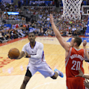 Los Angeles Clippers guard Chris Paul, left, puts up a shot as Houston Rockets forward Donatas Motiejunas, of Poland, defends during the second half of an NBA basketball game, Wednesday, Feb. 26, 2014, in Los Angeles The Associated Press