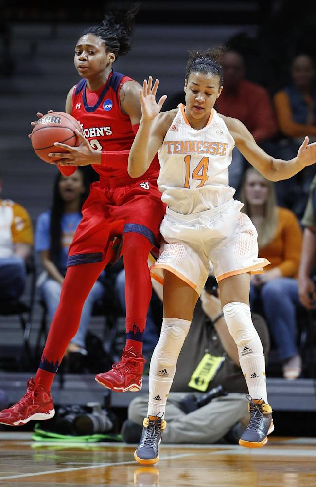 St. John's forward Amber Thompson, left, pulls a rebound away from Tennessee guard Andraya Carter (14) in the first half of an NCAA women's college basketball second-round tournament game Monday, March 24, 2014, in Knoxville, Tenn