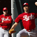 Cincinnati Reds manager Bryan Price, left, watches pitcher Jeff Francis during spring training baseball practice in Goodyear, Ariz., Tuesday, Feb. 18, 2014 The Associated Press