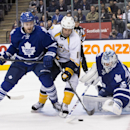 Toronto Maple Leafs goaltender Jonathan Bernier, right, makes a save as Nashville Predators' David Legwand, center, and Leafs' Cody Franson look for a rebound during the first period of an NHL hockey game, Thursday, Nov. 21, 2013 in Toronto The Associated