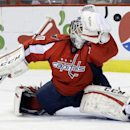 Washington Capitals goalie Braden Holtby deflects a puck as he defends the goal during the second period of an NHL hockey game in Washington, Friday, Nov. 29, 2013. Washington Capitals won 3-2 in overtime The Associated Press
