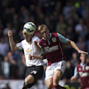 Burnley's Scott Arfield, right, fights for the ball against Manchester United's Darren Fletcher during their English Premier League soccer match at Turf Moor Stadium, Burnley, England, Saturday Aug. 30, 2014
