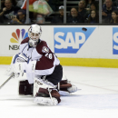 Colorado Avalanche goalie Reto Berra, of Switzerland, is beaten for a goal on a shot from San Jose Sharks' Patrick Marleau during the first period of an NHL hockey game on Friday, April 11, 2014, in San Jose, Calif The Associated Press