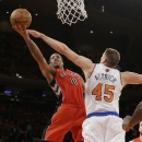 Toronto Raptors' DeMar DeRozan (10) drives past New York Knicks' Cole Aldrich (45) during the second half of an NBA basketball game Wednesday, April 16, 2014, in New York. The Knicks won the game 95-92 The Associated Press