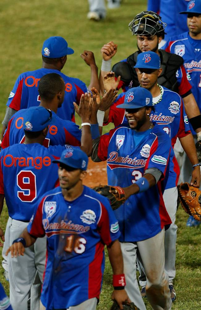 Players of the Dominican Republic celebrate after they defeated Cuba 9-2 during a Caribbean Series baseball game in Porlamar, Venezuela, Monday, Feb. 3, 2014