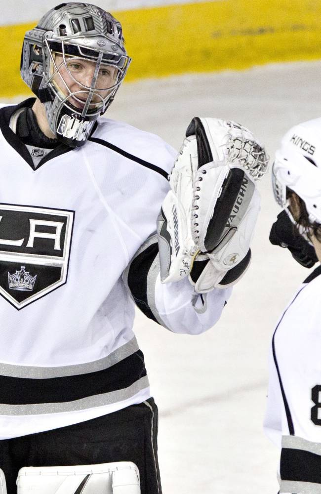 Los Angeles Kings goalie Jonathan Quick and Drew Doughty (8) celebrate the win over the Edmonton Oilers during NHL hockey action in Edmonton, Alberta, on Sunday March 9, 2014