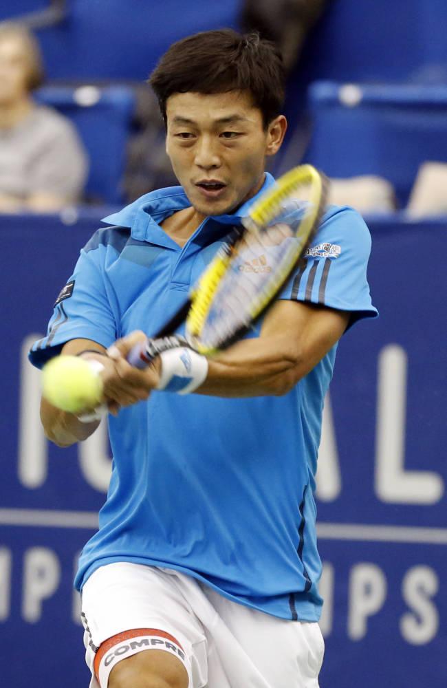 Lu Yen-Hsun, of Taiwan, hits a return to Alex Kuznetsov in the quarterfinal match at the U.S. National Indoor Tennis Championships, Friday, Feb. 14, 2014, in Memphis, Tenn