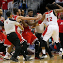 Nene #42 of the Washington Wizards scuffles with Jimmy Butler #21 of the Chicago Bulls as Joakim Noah #13 tries to break up the incident in fourth quarter action of Game 3 of the Eastern Conference Quarterfinals against the Chicago Bulls during the 2014 NBA Playoffs at the Verizon Center on April 25, 2014 in Washington, DC. Nen was ejected from the game when two technical fouls were called on the play. The Bulls won the game 100-97. (Photo by Win McNamee/Getty Images)
