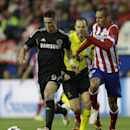 Chelsea's Fernando Torres, left, is challenged by Atletico's Miranda during the Champions League semifinal first leg soccer match between Atletico Madrid and Chelsea at the Vicente Calderon stadium in Madrid, Spain, Tuesday, April 22, 2014