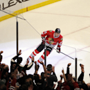 Chicago Blackhawks' Marian Hossa (81) skates after scoring the game-winning goal against the Minnesota Wild in a shootout during an NHL hockey game in Chicago, Thursday, April 3, 2014. The Blackhawks won 3-2 The Associated Press
