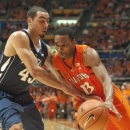 Penn State's Ross Travis (43) pressures Illinois' Tracy Abrams (13) during the first half of an NCAA college basketball game Thursday, Feb. 21, 2013, in Champaign, Ill. (AP Photo/Robert K. O'Daniell)