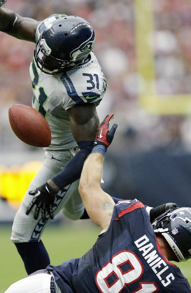 Seattle Seahawks' Kam Chancellor (31) breaks up a pass intended for Houston Texans' Owen Daniels (81) during the first quarter an NFL football game on Sunday, Sept. 29, 2013, in Houston. Seahawks' Earl Thomas made an interception off the tipped ball