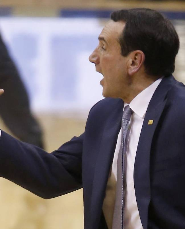 Duke head coach Mike Krzyzewski instructs his team during the second half of an NCAA college basketball game against Pittsburgh on Monday, Jan. 27, 2014, in Pittsburgh. Duke won 80-65