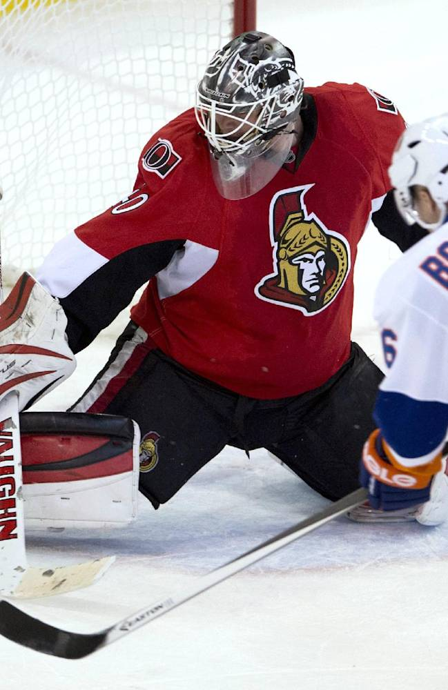 New York Islanders center Pierre-Marc Bouchard chases a rebound from Ottawa Senators goalie Robin Lehner during the second period of an NHL hockey game Friday, Nov. 1, 2013, in Ottawa, Ontario