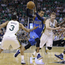 Dallas Mavericks' Monta Ellis (11) drives to the basket as Utah Jazz's Trey Burke (3) and Gordon Hayward (20) defend during the first quarter of an NBA basketball game Tuesday, April 8, 2014, in Salt Lake City The Associated Press