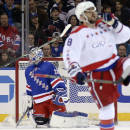 New York Rangers goalie Cam Talbot (33) kneels in the net after giving up a second goal to Washington Capitals left wing Alex Ovechkin (8) during the second period of an NHL hockey game, Sunday, March 29, 2015, in New York. (AP Photo/John Minchillo)