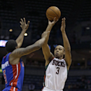In this Jan. 22, 2014 file photo, Milwaukee Bucks' Caron Butler (3) shoots against Detroit Pistons' Kentavious Caldwell-Pope, left, during the second half of an NBA basketball game in Milwaukee. Butler has agreed to sign with the Oklahoma City Thunder, ac