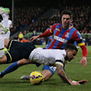Tottenham Hotspur's Kyle Walker, front, and Crystal Palace's Martin Kelly compete for the ball during the English Premier League soccer match between Crystal Palace and Tottenham Hotspur at Selhurst Park, London, England, Saturday, Jan. 10, 2015