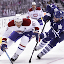 Montreal Canadiens' Max Pacioretty, left, skates pass Toronto Maple Leafs' Dion Phaneuf towards goal to score during first period NHL action in Toronto on Wednesday, Oct. 8, 2014 The Associated Press