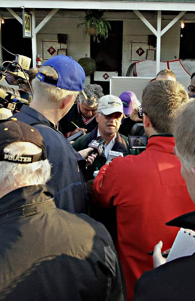 Trainer Art Sherman, center, speaks to the media about Kentucky Derby 140 winner California Chrome, outside Barn 20 at Churchill Downs in Louisville, Ky., Sunday, May 4, 2014