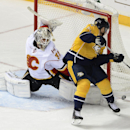 Calgary Flames goalie Karri Ramo (31), of Finland, stops a shot by Nashville Predators center Derek Roy (21) during a shootout at an NHL hockey game Tuesday, Oct. 14, 2014, in Nashville, Tenn. The Calgary Flames won 3-2 The Associated Press