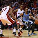 MIAMI, FL - DECEMBER 27: Mike Conley #11 of the Memphis Grizzlies brings the ball up during a game against the Miami Heat at American Airlines Arena on December 27, 2014 in Miami, Florida. (Photo by Mike Ehrmann/Getty Images)