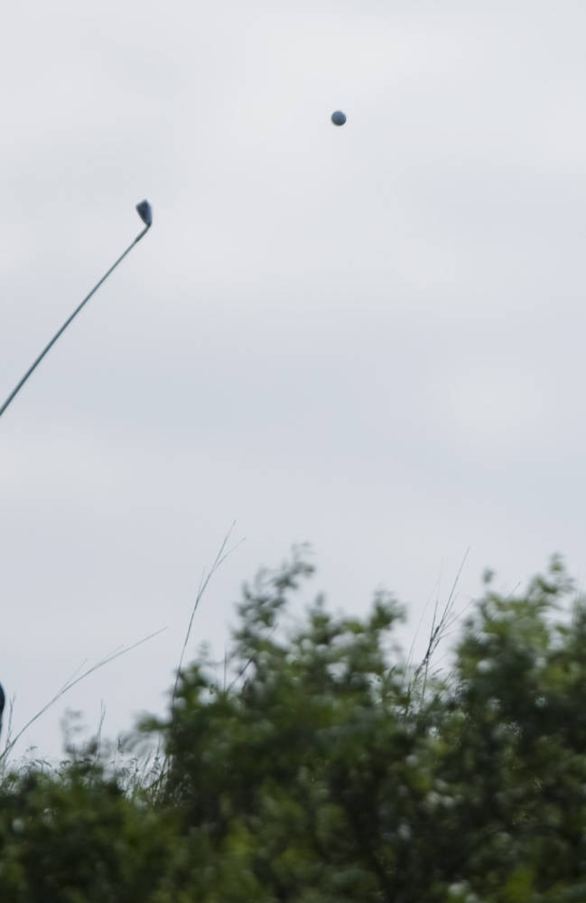 Oklahoma's Charlie Saxon drives the ball on the third hole during the NCAA men's Division I golf championships at Prairie Dunes Country Club in Hutchinson, Kan., on Saturday, May 24, 2014