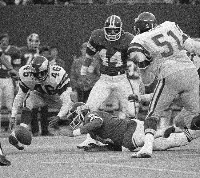 In this Nov. 19, 1978, file photo, Philadelphia Eagles' Herman Edwards pounces on the ball just fumbled by New York Giants quarterback Joe Pisarcik late in an NFL football game in East Rutherford. Edwards went in for the score and the Eagles won 19-17. The Eagles have enjoyed some of their greatest moments on the road against the Giants. Chip Kelly, the Eagles' coach, certainly doesn't need a refresher course before Sunday's game between the two struggling teams. He knows Philadelphia (1-3) and New York (0-4) go back a long way