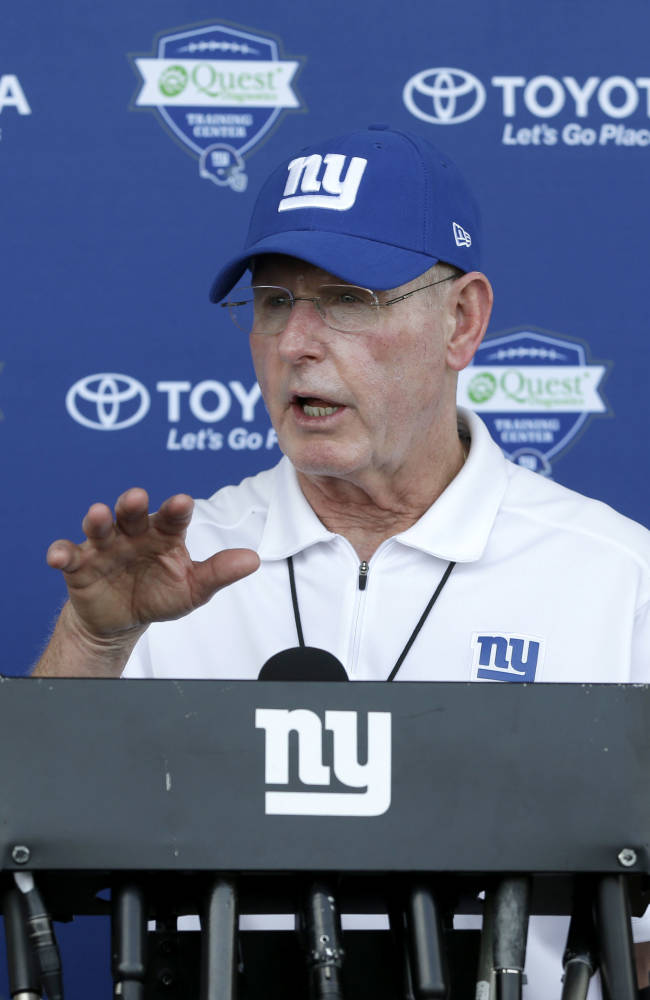 New York Giants head coach Tom Coughlin talks to reporters at NFL football training camp in East Rutherford, N.J., Tuesday, July 22, 2014