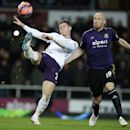 Everton's Ross Barkley, left, clears the ball from West Ham United's James Collins during their English FA Cup third round replay soccer match between West Ham United and Everton at the Boleyn Ground stadium in London, Tuesday, Jan. 13, 2015