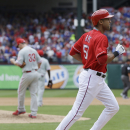 Texas Rangers' Alex Rios heads to home after hitting a three-run home run off Philadelphia Phillies starting pitcher Cliff Lee during the third inning of an opening day baseball game at Globe Life Park, Monday, March 31, 2014, in Arlington, Texas The Asso
