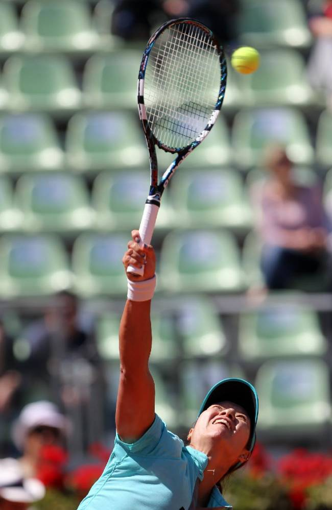 China's Na Li serves the ball to Australia's Samantha Stosur during their match at the Italian open tennis tournament in Rome, Thursday, May 15, 2014