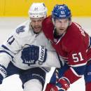 Toronto Maple Leafs' Olli Jokinen, left, gets up close to Montreal Canadiens' David Desharnais during second period NHL hockey action Saturday, Feb. 28, 2015 in Montreal. (AP Photo/The Canadian Press, Paul Chiasson)