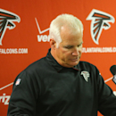Atlanta Falcons head coach Mike Smith speaks at a news conference after an NFL football game against the Carolina Panthers, Sunday, Dec. 28, 2014, in Atlanta. The Carolina Panthers won 34-3. (AP Photo/Atlanta Journal-Constitution, Curtis Compton)