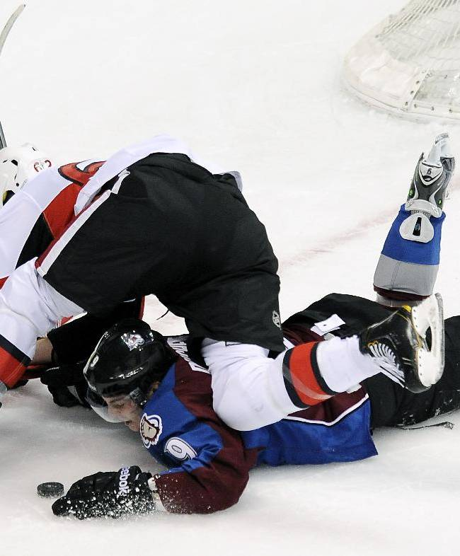 Ottawa Senators defenseman Eric Gryba, top, falls on Colorado Avalanche center Matt Duchene, bottom, in front of the net in the third period of an NHL hockey game on Wednesday, Jan. 8, 2014, in Denver. The Avalanche won 4-3 in overtime
