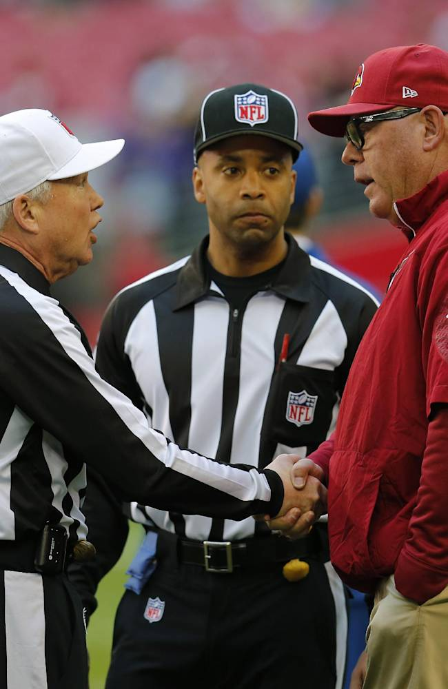 Arizona Cardinals head coach Bruce Arians, right, greets referee Walt Coleman (65) prior to an NFL football game, Sunday, Dec. 8, 2013, in Glendale, Ariz