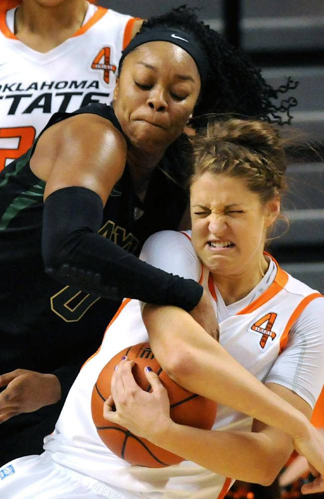 Baylor guard Odyssey Sims, left, struggles for the ball with Oklahoma State forward Katelyn Loecker, during the second half of an NCAA college basketball game in Stillwater, Okla., Sunday, Jan. 26, 2014. Sims scored 17 points in the 69-66 win over Oklahoma State